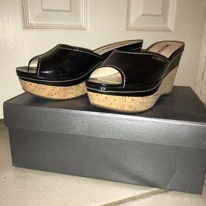 Prada black patent leather wedges